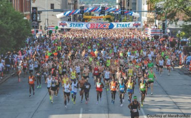 Almost 20,000 runners begin the climb up Brady Street at the start of the Bix 7.